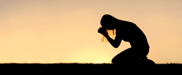 Christian Woman Sitting Down in Prayer Silhouette